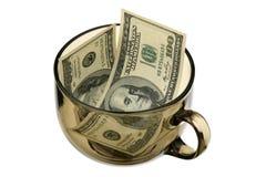 Dólares en un vidrio imagen de archivo libre de regalías