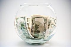 Dólares en una botella Imágenes de archivo libres de regalías