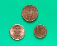 Dólares, Euro e libras - 1 centavo, 1 moeda de um centavo Fotografia de Stock Royalty Free