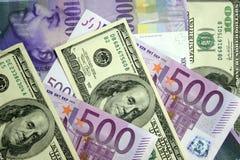 Dólares, euros, franco suizo Imágenes de archivo libres de regalías