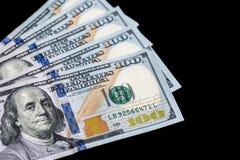 Dólares isolados no fundo preto Imagens de Stock Royalty Free