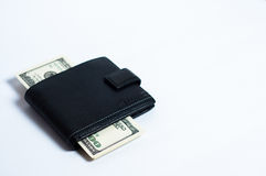 Dólares na carteira preta no branco Fotografia de Stock