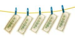 Dólares na corda Foto de Stock