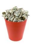 Dólares na lata de lixo vermelha Fotografia de Stock