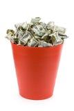Dólares na lata de lixo vermelha Imagem de Stock Royalty Free