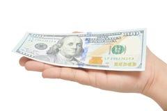 Dólares na mão Fotografia de Stock
