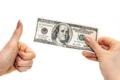 Dólares na mão Imagem de Stock