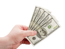 Dólares na mão do homem Imagem de Stock
