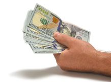 Dólares na mão dos homens Fotografia de Stock
