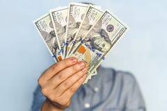 Dólares nas mãos Fotos de Stock