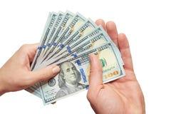 Dólares nas mãos em um fundo branco Fotografia de Stock Royalty Free