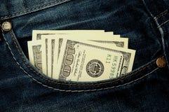 Dólares no bolso Imagem de Stock