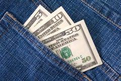 Dólares no bolso imagens de stock