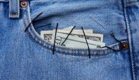 Dólares no bolso fotografia de stock