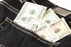 Dólares no bolso das calças de brim Imagens de Stock