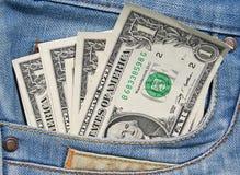 Dólares no bolso das calças de brim Fotos de Stock Royalty Free