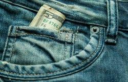 5 dólares no bolso das calças de brim Imagens de Stock Royalty Free