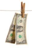 Dólares no clothespin Fotos de Stock