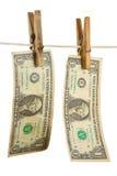 Dólares no clothespin Imagem de Stock