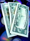 Dólares no disco CD Imagem de Stock