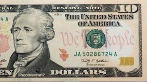 Dólares no fundo branco Fotografia de Stock