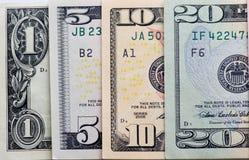 Dólares no fundo branco Fotografia de Stock Royalty Free