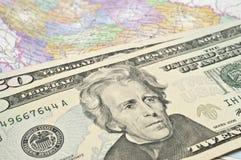Dólares no mapa Fotografia de Stock
