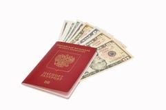 Dólares no passaporte internacional Imagens de Stock