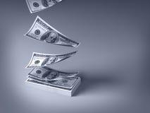 Dólares que caem para baixo Fotografia de Stock