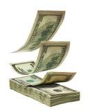 Dólares que caen a empilar Imagen de archivo