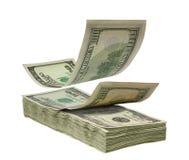 Dólares que caen a empilar Fotos de archivo