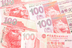 100 dólares son la divisa nacional de Hong Kong Fotos de archivo libres de regalías