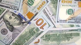 Dólares verdes de E.E.U.U. Textura de billetes de banco El dinero está haciendo girar lentamente el primer 4k metrajes