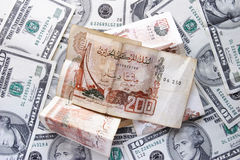 Dólares y dinar Imágenes de archivo libres de regalías