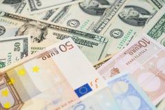 Dólares y euro Fotos de archivo libres de regalías
