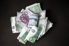 Dólares y euros fotografía de archivo libre de regalías