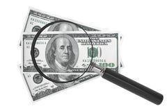 Dólares y lupa Imagen de archivo libre de regalías