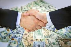 Dólares y manos americanos Imagen de archivo libre de regalías