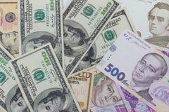 dólares y nuevo hryvnia ucraniano Foto de archivo