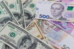 dólares y nuevo hryvnia ucraniano Imágenes de archivo libres de regalías