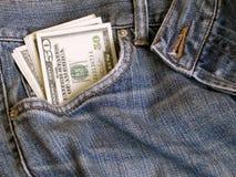 Dólares y pantalones vaqueros Fotos de archivo libres de regalías