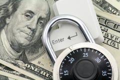 Dólares y un clave de introducir Imágenes de archivo libres de regalías