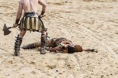 Död gladiatorstridighet i arenan av den romerska cirkusen Royaltyfri Bild
