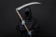 Dödskördemaskin över svart bakgrund halloween Royaltyfri Foto