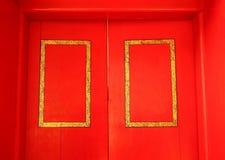 Dörr för röd färg Fotografering för Bildbyråer