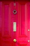 Dörr med bronsprydnader Royaltyfri Foto