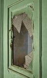Dörr med brutet exponeringsglas royaltyfri bild