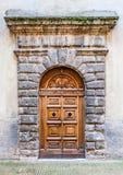 Dörrdetalj av den Ducale slotten i den Urbino staden, Marche, Italien Fotografering för Bildbyråer