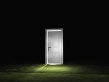 Dörren sänder ut lampa Arkivbild