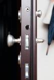 Dörrlåset i ett hem Arkivfoto